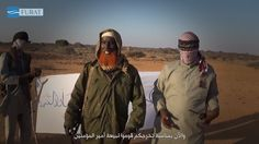 Abdulqadr Mumim, center, with red beard. Image from an Islamic State video…