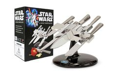 Star Wars X-Wing Knife Block Officially licensed Star Wars knife set looks like X-Wing spacecraft. Star Wars X-Wing knife block comes with stainless steel cook's knife, bread knife, carving knife, utility knife, and paring knife. Knife Block Set, Knife Sets, X Wing Star Wars, Cocina Star Wars, Star Wars Kitchen, Knife Stand, X Wing Fighter, Knife Holder, Deco Originale