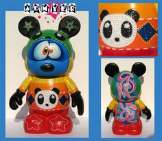 """Admyer- Rainbow Mouse character. This was done on a 9"""" vinylmation that features all the colors of the rainbow. The front has a cute panda design on the belly and on the back is my name in a graffiti style. (Admyer)"""
