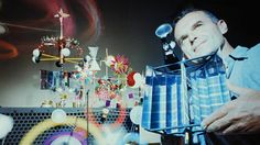 Charles Eames with a solar toy