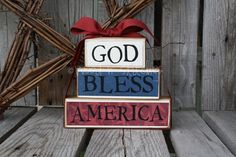 """GOD BLESS AMERICA"" Stacker:  ""God"" - 2.5"" x 5"" - cream paper, black vinyl;  ""Bless"" - 2.5"" x 5.5"" - blue paper, black vinyl;   ""America"" - .5"" x 9"" - red paper w/stars, black vinyl;  Ribbon: black or dark red  Total Size: 7.5"" x 9"""