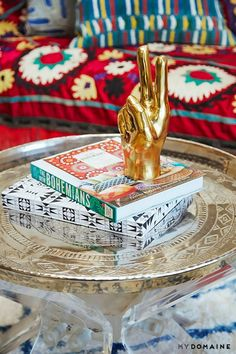 Well styled coffee table with books and a gold statue