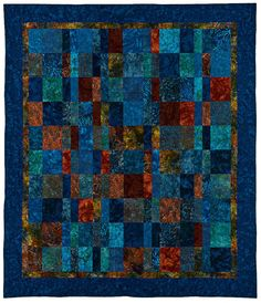 This strippy quilt in rich colors was made with a large selection of high-end batik fabrics, including coppers, rusts, teals, and blues. Measuring