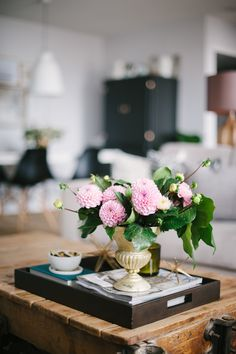 #coffee-table, #floral-arrangement  Photography: Heidi Lau - www.heidilau.ca  Read More: http://www.stylemepretty.com/living/2014/09/29/lark-linen-home-tour/