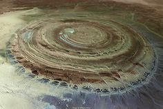 The Eye of the Sahara, Mauritania This mysterious blue eye has puzzled scientist since the first space flights, when astronauts noticed it looking back at them. Space shuttles use the 50 km-wide feature as a landmark even today, it is so clear in the middle of the barren Sahara desert. Read Full Article At: http://www.mediadump.com/hosted-id186-most-fascinating-geological-wonders-on-earth.html#ixzz1ahiZaPF8