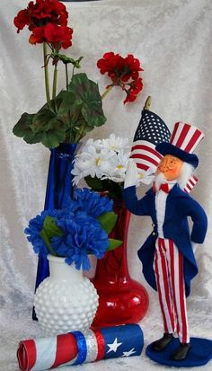 Red, White, and Blue Patriotic Centerpiece With $1.00 vases, it is inexpensive to do! Great for Patriotic holidays!