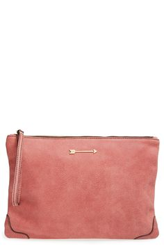 This sleek leather clutch would be perfect for stashing small essentials on the go.