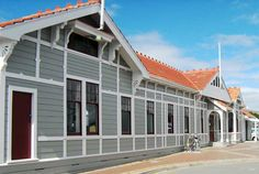 The historic Blenheim Railway Station built in the early in New Zealand is repainted in Resene Double Delta, Resene Conrete and Resene Nelson Red. Resene Colours, State Of Arizona, South Island, Back In Time, South Pacific, New Zealand, Places To Visit, Exterior, Mansions