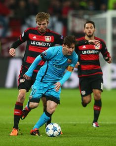 Lionel Messi of Barcelona holds of Christoph Kramer of Bayer Levekusen during the UEFA Champions League Group E match between Bayer 04 Leverkusen and FC Barcelona at BayArena on December 9, 2015 in Leverkusen, Germany.