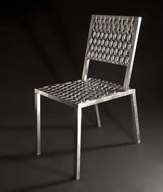 Brazilian designer Leo Capote worked at his grandfather's hardware store for 20 years before meeting the Campana Brothers as customers. They offered him an internship at their firm if he went to college. His big break came when he found a chair structure that the firm had discarded and he covered it with 233 soup spoons. The Campana Brothers representative at the time, Marco 500, then invited him to create a line.