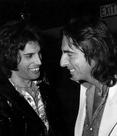 Freddie Mercury and Alice Cooper Smiling Black and white