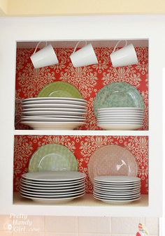 DIY on a Dime Tutorial: Fabric-Backed Open Kitchen Cabinets Courtesy of Pretty Handy Girl.