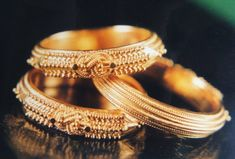 Payyanur Pavithra Mothiram is a world famous ring used by millions of people in Kerala and abroad. What's more striking about this ring is its intricate design which can only be made by a particular gold worker class community in a village in Payyanur. This uniquely crafted ring is very hard to make and often takes weeks to make the delicate and peculiar design. The name is derived from a ring made of Durba grass which was used by Temple priests while performing offerings to Temple deities.