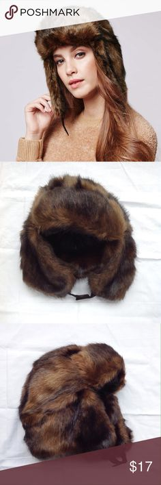 TOPSHOP Faux Fur Bear Trapper Hat Keep warm in the coming winter months with this TOPSHOP soft, silky brown and black faux fur bear trapper hat, complete with quilted lining and a black clasp. One Size. 84% modacrylic, 16% polyester. Machine washable. Safely stored in a bag to keep dust away. Thanks for looking! Topshop Accessories Hats
