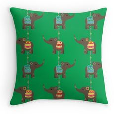 Elephant charms in green pillow http://www.redbubble.com/people/hollyddesigns