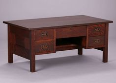 Gustav Stickley five-drawer coffee table.  Originally a taller desk.  Unsigned.  Refinished.  43″w x 24″d x 19″h
