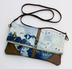 hand bleached denim foldover bag with removable leather strap