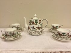 "Crown Staffordshire tea set  10 piece fine bone china  ""Hunting Scene"" collector's pattern  Featured on One King's Lane This includes four tea cups, four saucers, one tea pot, and one lid.   by GidgetsVintageFinds"