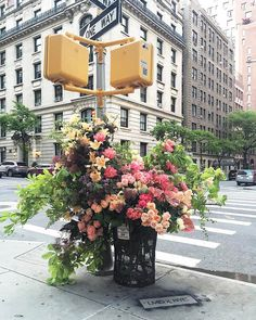 New York Florist, Lewis Miller, and his team turn trash cans into large, huge vases overflowing with color, by filling them with floral arrangements. Flower Bomb, My Flower, Flower Vases, Cactus Flower, Fresh Flowers, Beautiful Flowers, Beautiful Bouquets, City Flowers, Exotic Flowers