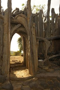 A fence with archway made of driftwood