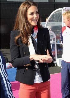 Duchess of Cambridge / silk scarf / black jacket / orange pants / golden buttons