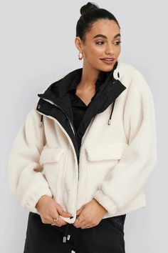 This jacket features a drawstring hood, a teddy material, a hidden zipper down the front, two pockets and long sleeves with elasticized cuffs. Jean Jacket Outfits, Teddy Coat, Shearling Jacket, Street Style, Winter Fashion Outfits, World Of Fashion, Hoods, Hooded Jacket, My Style