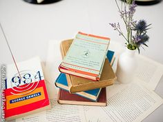 Use stacks of old books as wedding centerpieces. An Event Less Ordinary Chicago Illinois Coordinator / Wedding Planner