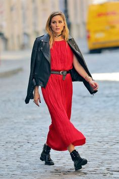 Looking radiant in red, Olivia Palermo showed us how an otherwise feminine frock is instantly cooler when toughened up via lace-up combat boots and a leather jacket. With a black choker and edgy belt punctuating the look, the ensemble is quintessentially Combat Boots Dress, Combat Boot Outfits, Dress With Boots, Estilo Olivia Palermo, Olivia Palermo Style, Skater Girl Outfits, Outfits Otoño, Converse Outfits, Celebrity Outfits
