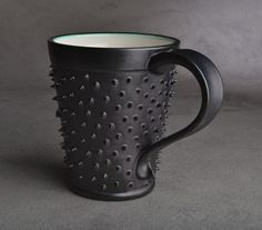 """Want this!!! """"– the spikey coffee mug is a handmade cup that takes no prisoners and lives by its own rules."""" haha!"""