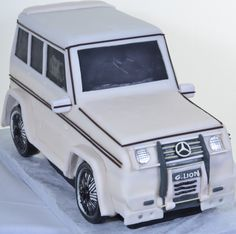 "Pastry Palace Las Vegas - ""Mercedes SUV."" Mercedes-shaped cake in white. Specialty and Grooms Cake #741."