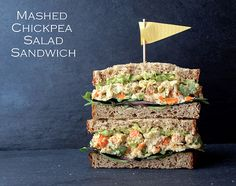 Mashed Chickpea Salad Sandwich: garbanzo, celery, carrots, scallions, mustard, lemon, seeds, hummus or mayo. Top with smashed avocado and put on bread.