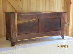 This is a walnut chest excellent for blankets, toys, games or whatever you want to store in it. This also makes a great coffee table or bench.