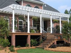 Attached White Pergola on Stately Home | Archadeck Outdoor Living