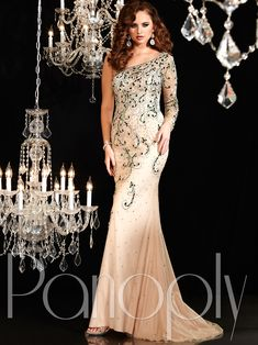 Become the top beauty by showing off your great silhouette wearing this stunning Panoply pageant gown. This beaded tulle Panoply pageant dress 44265 has a sheer one shoulder neckline with long sleeve, gorgeous fitted bodice embellished with jewels in a swirled design, and a trumpet skirt with a sweep train. The sheer illusion and beaded back adds elegance to this Panoply pageant gown. Finish this Panoply pageant dress with chunky rhinestone earrings and matching bracelet at…