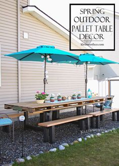 Gather friends and family around a pallet table built for dining alfresco. Colorful accessories and string lights balance this rustic style from Kleinworth & Co.