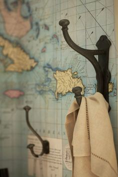 repurposed vintage map as wallpaper cool for an office or small feature wall - behind the entry/living room desk - with that molding and the hooks Map Wallpaper, Wallpaper Ideas, Feature Wallpaper, Bathroom Wallpaper, Map Globe, Boho Home, Childrens Room Decor, Kids Room Design, Reno