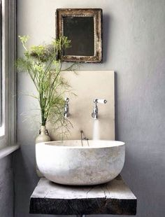 Love the sink, wooden table it's on, and the dill weed as decoration. Would look good with stone on the wall.