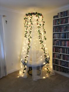 Our fairy fort reading nook we made with a Pier 1 papasan chair, an IKEA canopy, curtain lights and floral garlands. Such a magical place to read or nap!