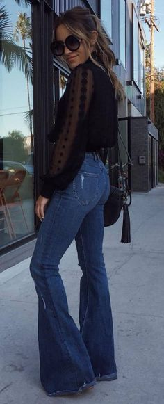 stylish look | black blouse + wide jeans + heels + bag