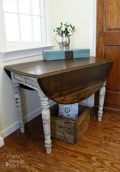 recycled drop leaf table....I like the fact that they kept the beauty of the wood onto.