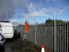Here is how an electric fence installation is done using Electro-Fence technology to improve perimeter security for a secure vehicle compound. Security Fencing, Perimeter Security, Wildlife Park, Fence Gate, Threading, Electric, Wall, Walls