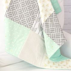 A mint, gold, and gray baby quilt like this is perfect for a gender neutral nursery!  Love these prints