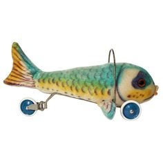 We bought this today. And a cage for it. It's art, you know.   Steiff Fish Riding Toy