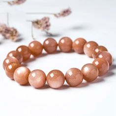 This simple fine orange sanstone bracelet is smooth, well polished with reasonable price, ideal for giving to others as a featured gift. Rutilated Quartz, Labradorite, Types Of Crystals, Orange Crystals, Crystal Pendant, Sun Stone, Stone Beads, Handmade Jewelry, Beaded Bracelets