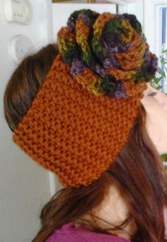 Knit headband in Russet yarn, with Harvest Variegated crocheted rose ,done by Jodi Villanella.
