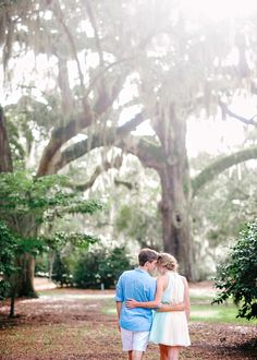 summer engagement portraits in Myrtle Beach with beautiful tress