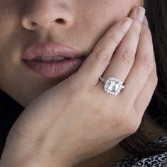 18 Karat White Gold Cushion Cut Diamond Halo White Topaz Engagement Wedding Ring. $2,400.00, via Etsy.