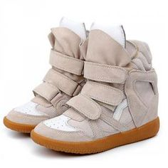 This gorgeous 2012 Isabel Marant sneakers style has the most gorgeous design and shades which features ivory and white color, pure white tongue, simple design which describe a incomparable glamour, breathing suede and leather makes the sensation true and cozy, you will also be fond of the wedge heels within about 2 inches of this pair of sneakers, making the legs look longer. Choose this amazing item, Isabel Marant always give you the extra surprise.
