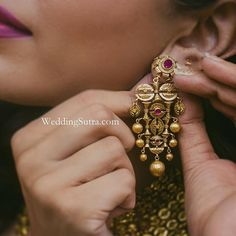 These vintage-inspired handcrafted gold earrings by Azva vows are a great buy for a modern bride.    Photo Courtesy - @houseontheclouds.films    #jewelry #bridaljewelry #earrings #goldjewellery #gold #handmadejewellery #jewellery #bridaljewellery #indianbride #lehenga #bridalwear #bridalfashion #ring #azvaweddingsutra #contemporaryjewellery #earring #unconventionalwedding #earrings #weddingsutra #weddinginspiration