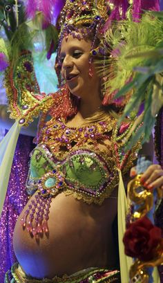 A pregnant reveller parades for the Camisa Verde e Branco Samba School during a carnival at the Anhembi Sambadrome in Sao Paulo. PAULO WHITAKER/REUTERS